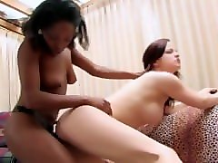 nasty redhead chick gets fuck with strapon by her ebony friend